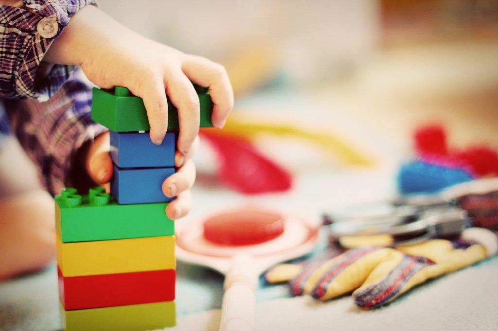 Child building legos